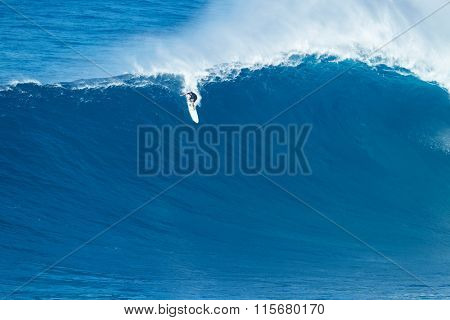 MAUI, HI - JANUARY 16 2016: Professional surfer Ian Walsh rides a giant wave at the legendary big wave surf break known as