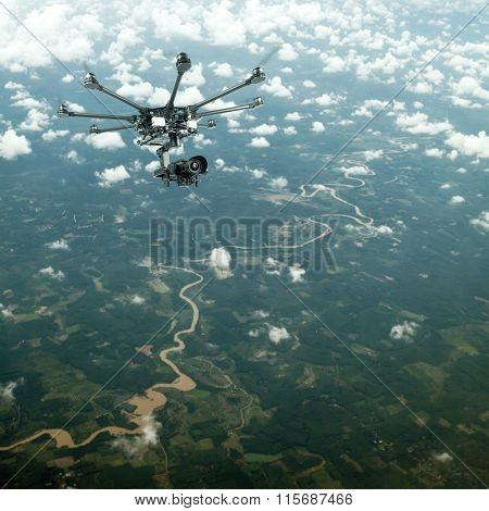 Copter flying over the countryside. Copter takes aerial view. Copter photographed from above. poster