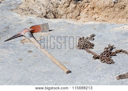 Mattock And Chain On Asphalt