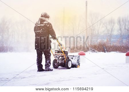 A Man Cleans Snow