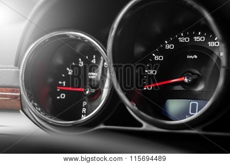 Modern Car Speedometer And Odometer At Daytime