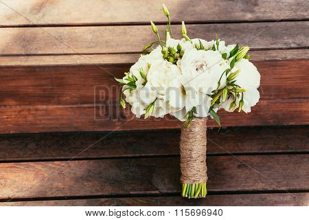 Rustic Wedding Bouquet On Brown Wooden Backgraund On Ceremony Place With Copy Space