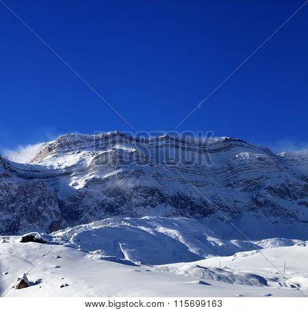 Snowy Rocks At Sun Windy Day