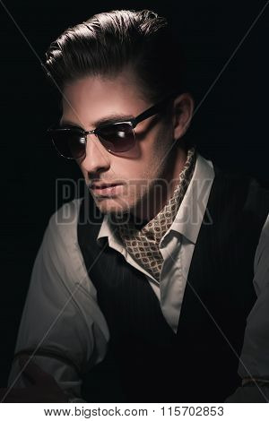 Handsome Retro Fashion Man With Vintage Shades In Waistcoat And Scarf. Slick Hair Combed Back. Again