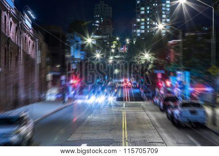 street tram / train in downtown San Francisco at night.
