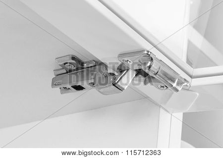 Closeup Of Furniture Cabinet Modern Clip Hinge With Amortization - Kitchen Slow Motion Hardware
