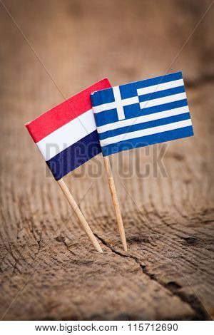 Flags of Netherlands and Greece on wooden background
