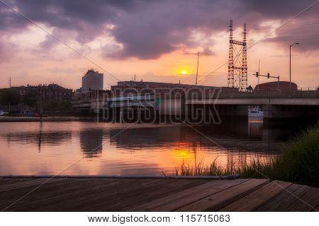 Bridge Over Calm Water At Sunset