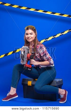 Plus-size Model On A Blue Background With The Construction Of The Protective Tape Safety Glasses Sit