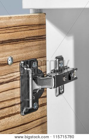 Closeup Of Furniture Cabinet Modern Clip Hinge With Amortization - Citchen Slow Motion Hardware