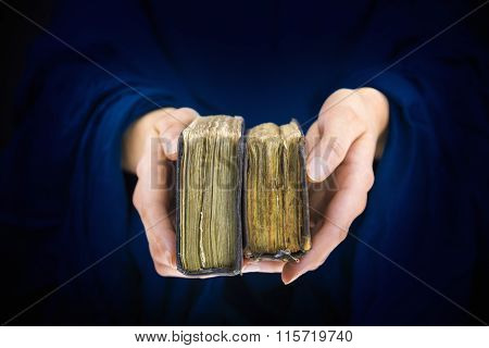 Woman's Hands Giving Two Old Books