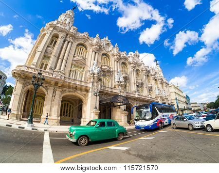HAVANA,CUBA- JANUARY 19,2015 : Street scene with old classic car next to the Grand Theater of Havana