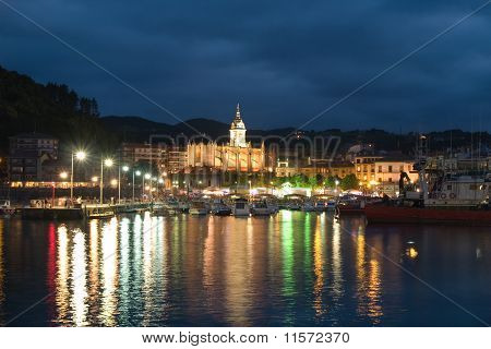 Gothic Basilica And Harbour In Lekeitio At Dusk