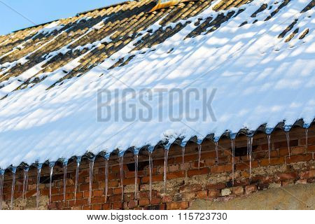 Icicles Hanging On A Roof.
