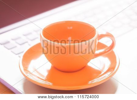 Closeup Coffee Cup On Laptop
