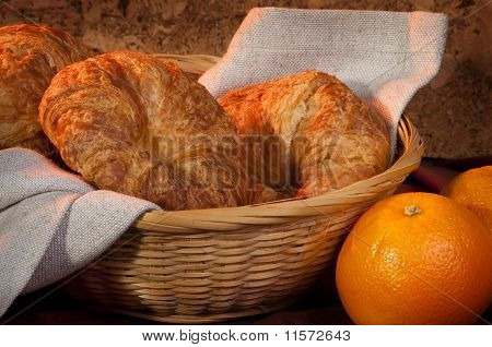 Freshly Made Breads Croissant Served For Breakfast With Orange Fruit