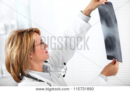 Mature doctor woman with a X-ray photograph.