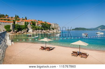Adriatic sea luxury sand beach with chaise-longue chairs and umbrellas