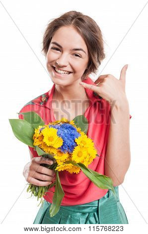 Woman Making Call Me Gesture With Hand While Holding Flowers.