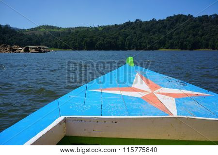 Traditional Wooden Boat In A Picture Perfect Tropical Bay On Danau Patenggang, Bandung, Indonesia