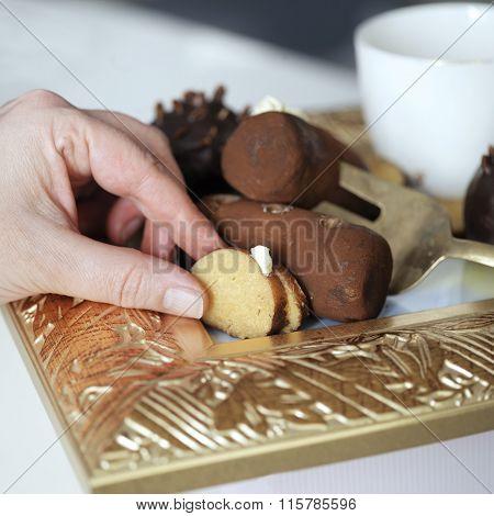 Hand Picking Up Cake