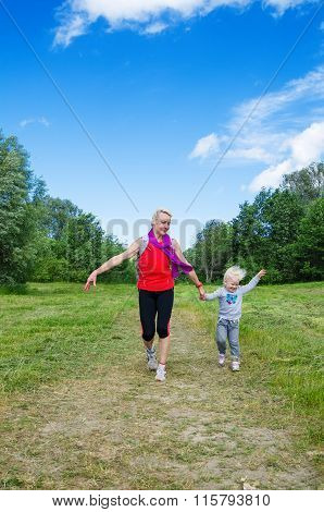 Woman With A Child On The Sports Outing