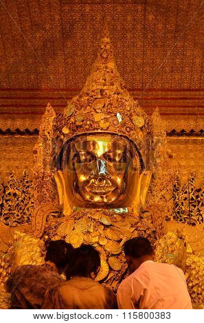 Mandalay - March 14 2015: The Myanmar People Venerated Buddha Statue With The Golden Paper At Mahamu