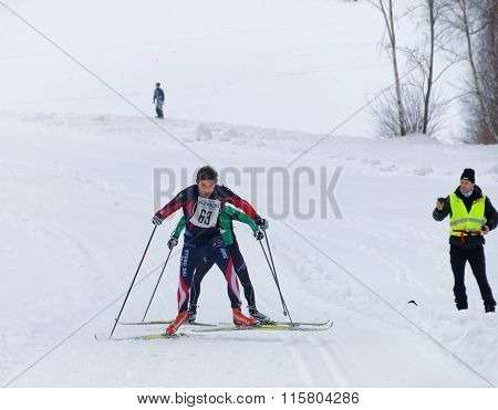 Two Cross Country Skiing Men Sprinting In A Uphill Slope