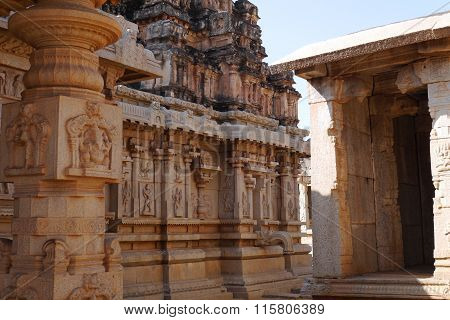 All temples in Hampi are similar, built in uniform style. The temple Bala-Krishna not an exception, nevertheless, here besides attracts attention the gateway temple (gapura) the sculptures carved columns and bas-reliefs. poster