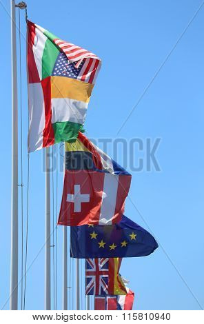 Flags Of Many Nations In The Wind On A Sunny Day