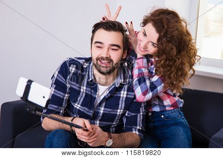 Happy Funny Couple Taking Photo With Cell Phone
