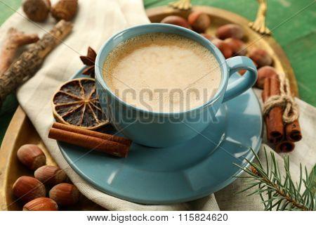 Cup of coffee on metal trey, closeup