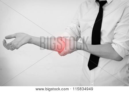 Office Man Touching Painful Elbow. Pain In A Man Elbow.