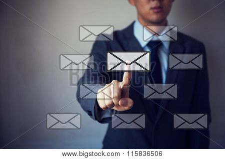 Businessman Touching Virtual Emails. Email Marketing Concept.