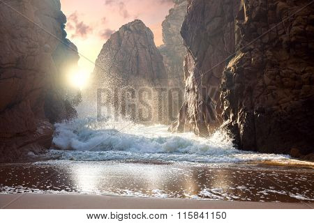 Fantastic big rocks and ocean waves at sundown time. Dramatic scene. Beauty world landscape.