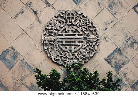 Chinese religious stone carving of flowers on the wall