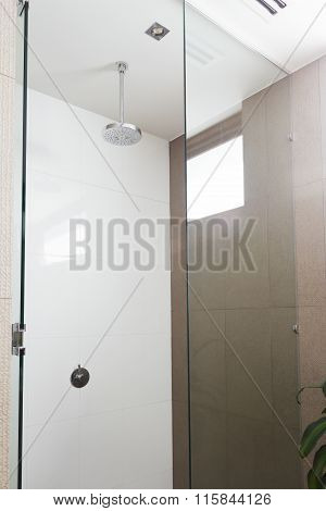 Close up of a contemporary shower and rain shower head in modern bathroom poster