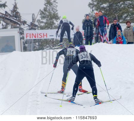 Two Cross Country Skiing People Sprinting In A Uphill Slope