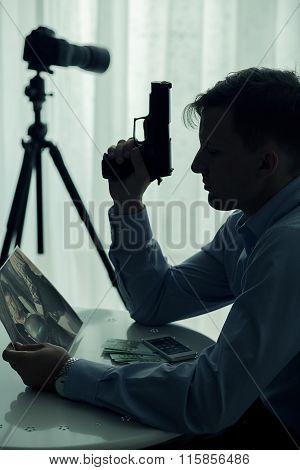 Murderer Holding Handgun