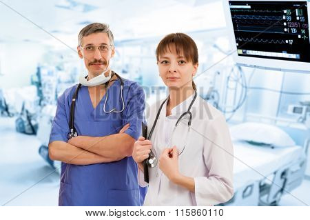 Two Doctors in Hospital with Monitor on Background