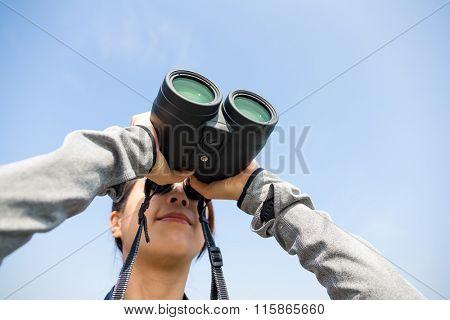 Woman looking though binocular