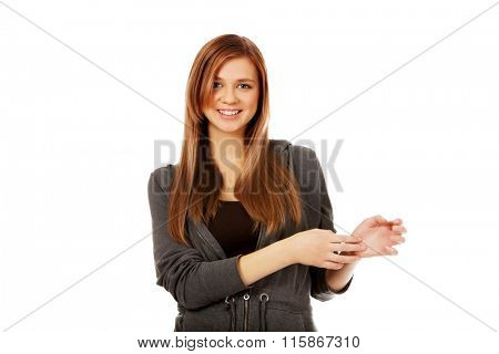 Young woman is scratching herself on wirst