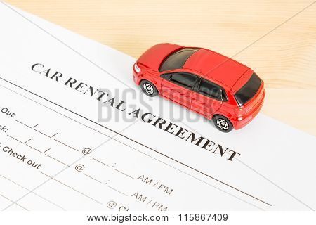 Car Rental Agreement With Red Car On Right View