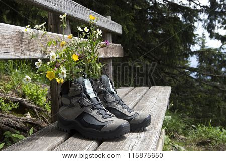 Hiking Shoes With Flowers On A Bench