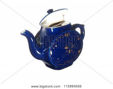 Old Ceramic Teapot Blue With Gold Pattern Isolated On White Background.
