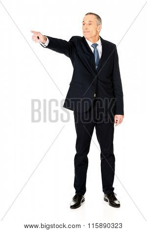 Full length boss dismissing someone