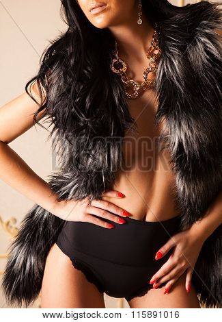 Fashionable Girl In Fur Jacket With Golden Jewellery