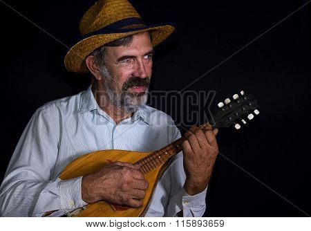 Portrait of an old country man with mandolin