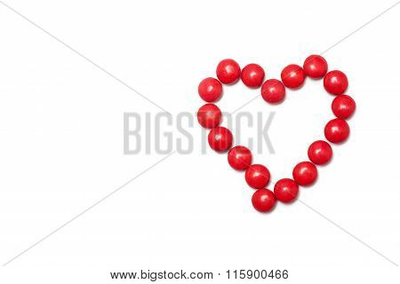 Heart of the red chocolate coated candy
