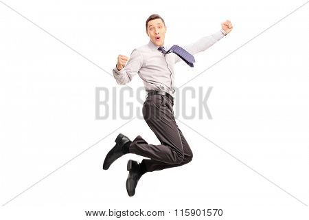 Joyful young businessman jumping and gesturing happiness shot in mid-air isolated on white background